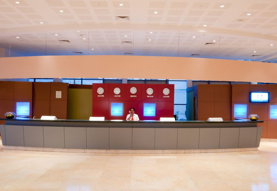 auditorium receptionist Lobby conference hall theatre convention center display device headquarters baggage claim