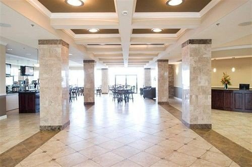 Lobby building property flooring wood flooring living room ballroom hard convention center auditorium mansion open empty tile tiled