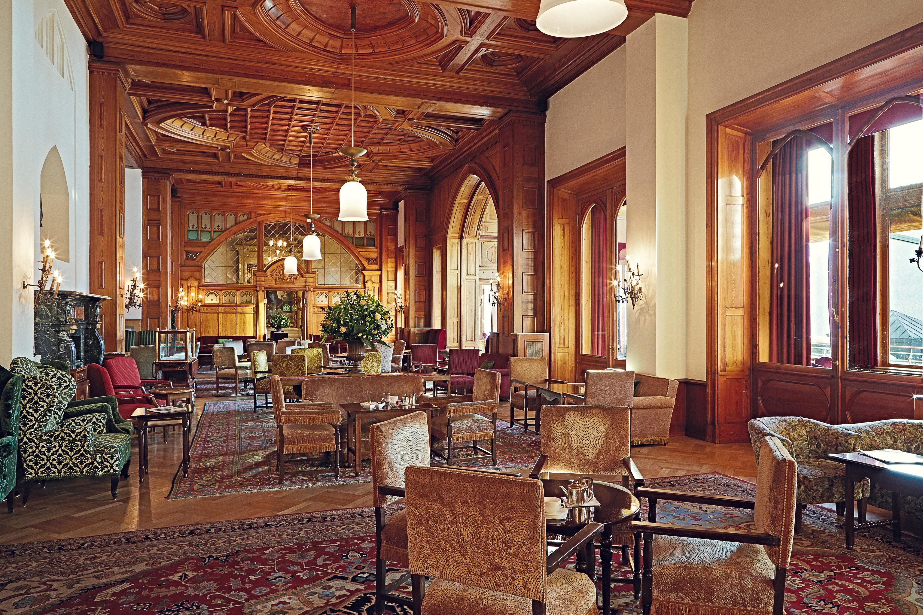 chair property Lobby building palace mansion home living room chapel hacienda ballroom function hall restaurant