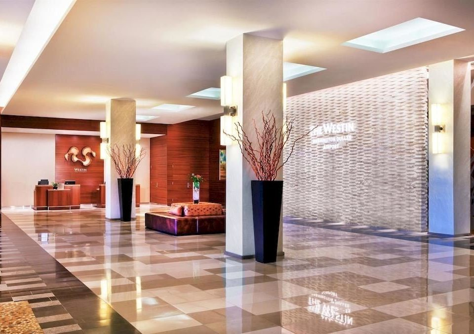 Lobby property building flooring lighting living room wood flooring function hall condominium counter ballroom