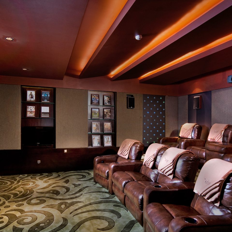 sofa property recreation room Lobby living room conference hall leather basement