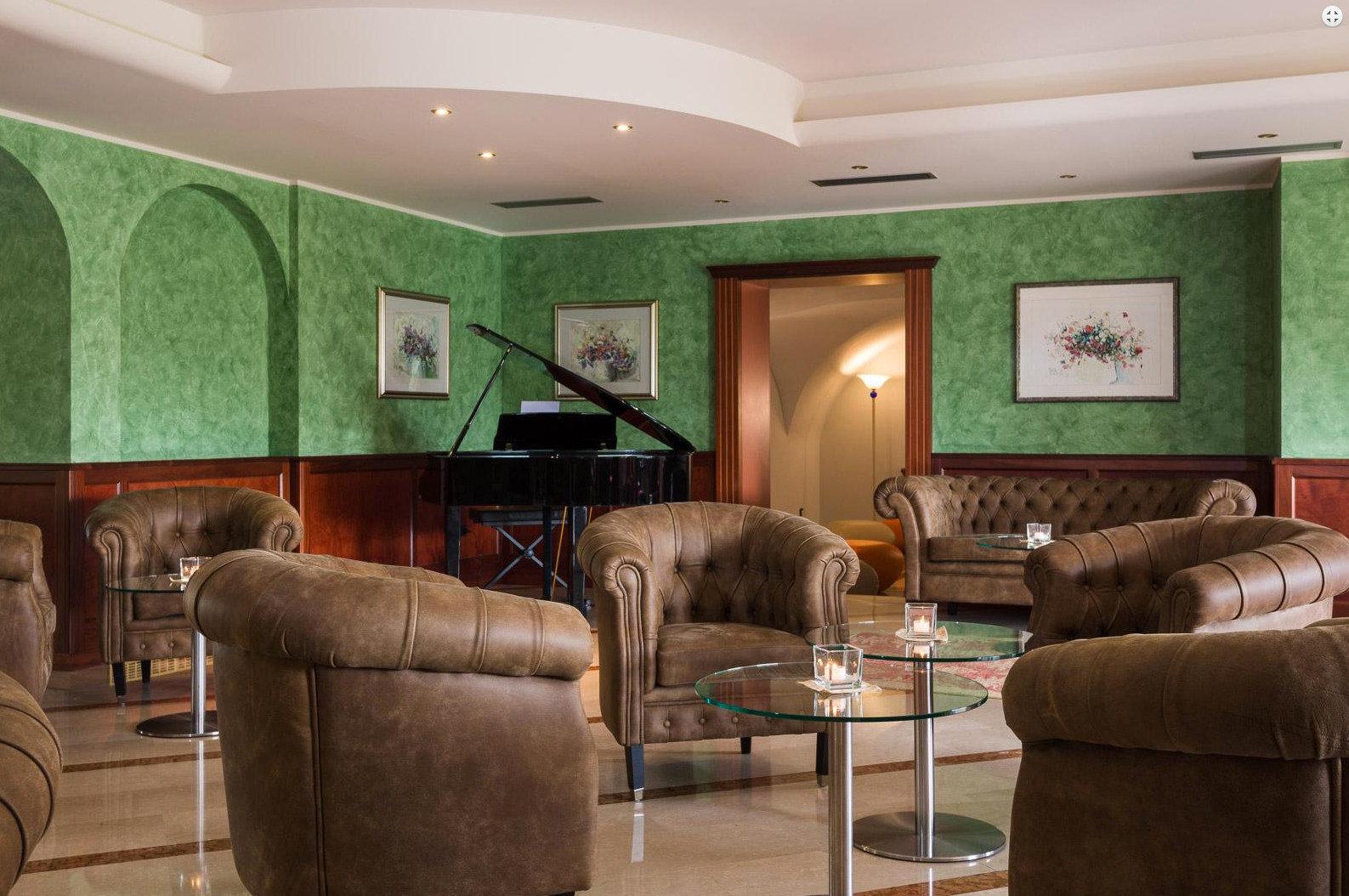 sofa property living room home green Lobby leather recreation room basement
