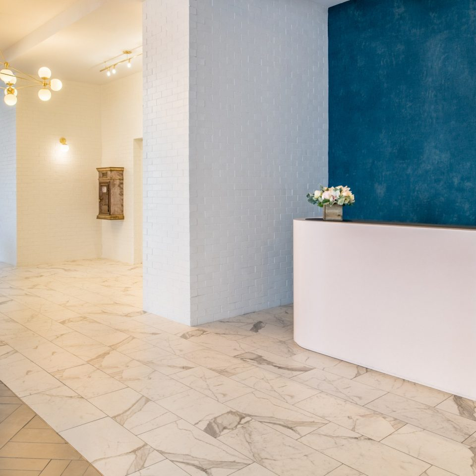 property tile flooring building wood flooring bathroom white laminate flooring product design home hardwood tap Lobby plaster daylighting interior designer tiled