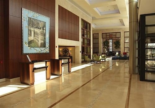 Lobby property building hardwood living room flooring home cabinetry wood flooring condominium tourist attraction mansion
