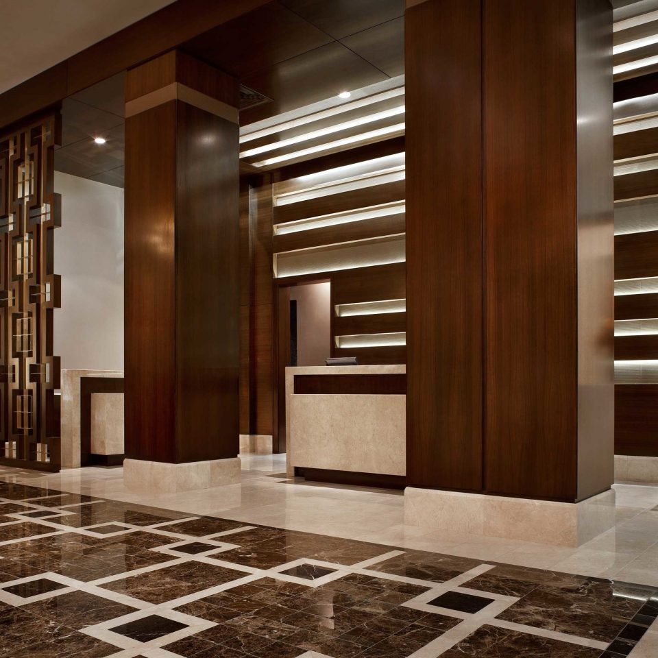 Lobby building hardwood flooring wood flooring hall living room cabinetry