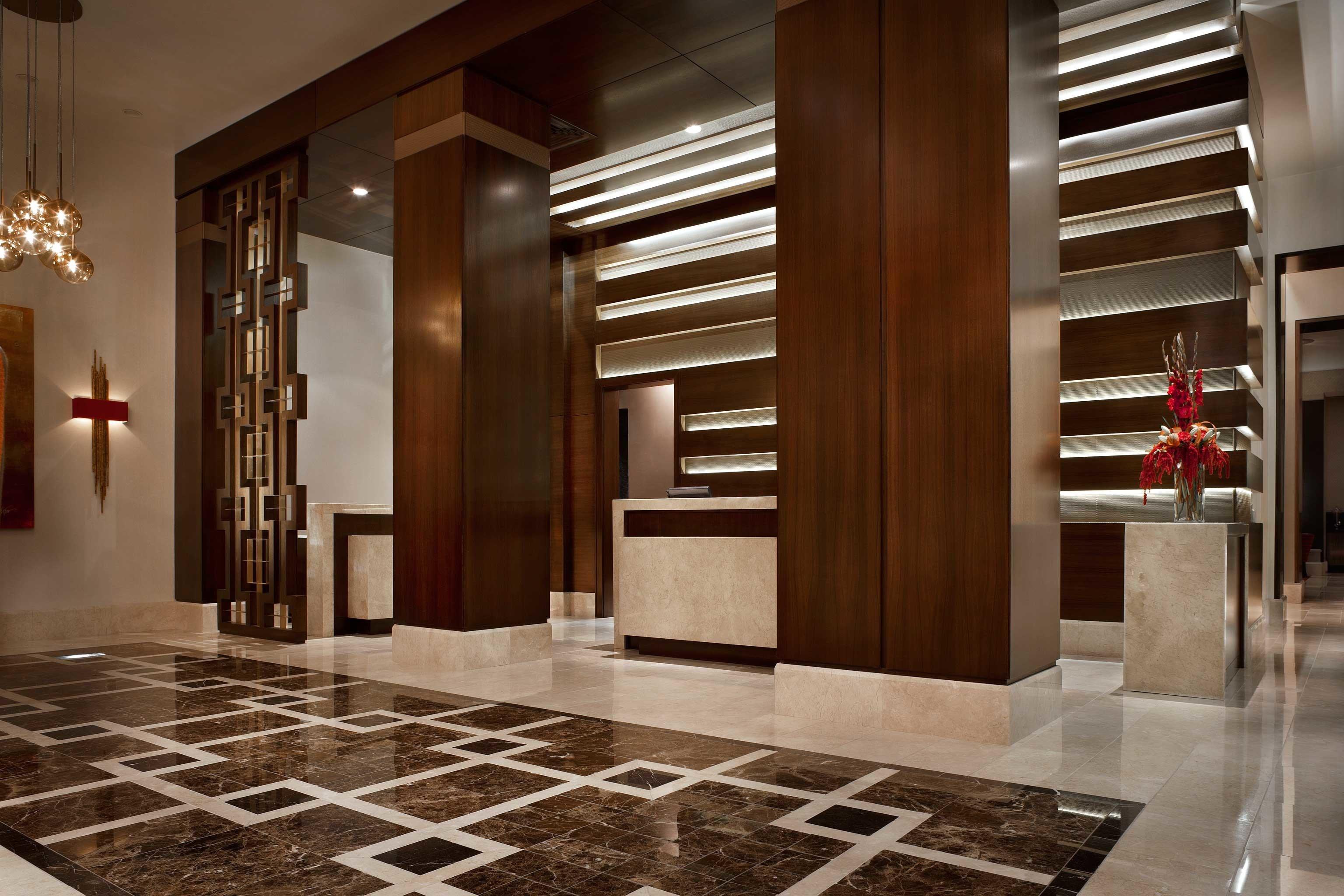 Lobby building hardwood flooring wood flooring hall living room cabinetry