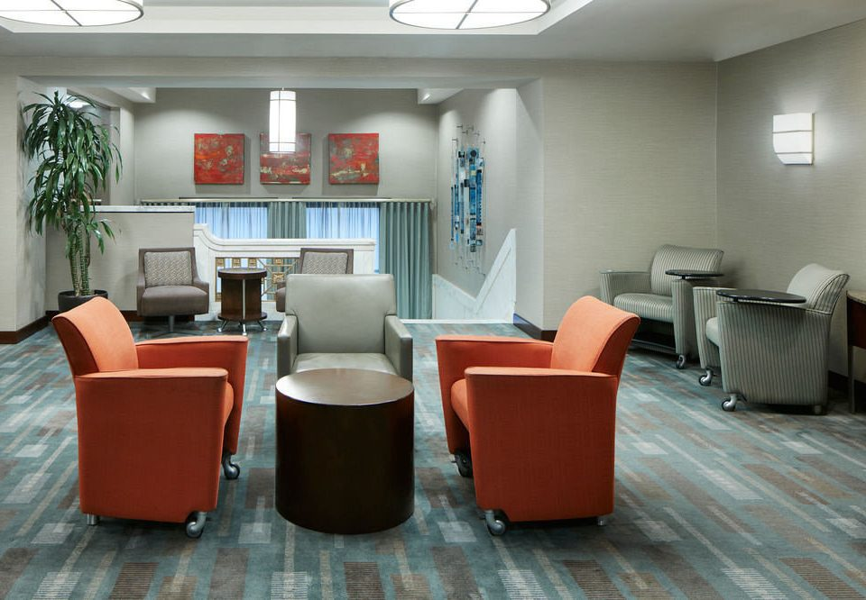 chair orange property office waiting room building living room home Lobby condominium leather