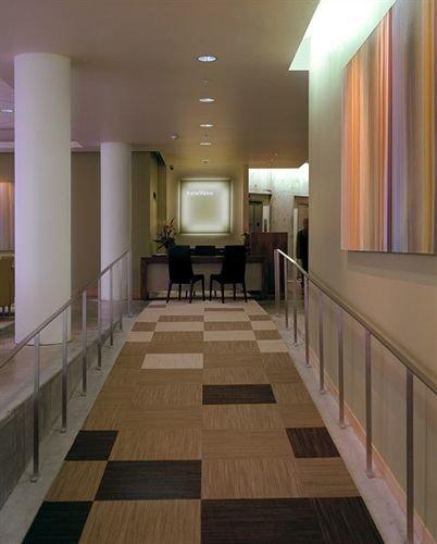 Lobby building property flooring hardwood hall wood flooring lighting home living room condominium mansion long tile tiled