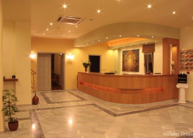 Lobby property building receptionist flooring wood flooring living room function hall mansion
