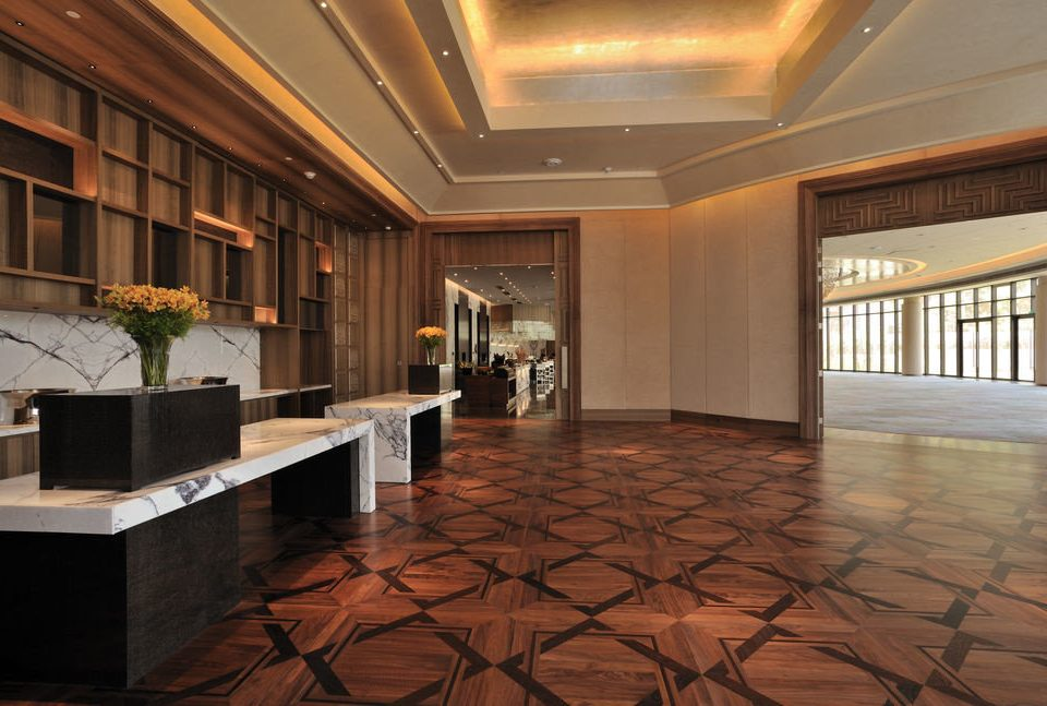 Lobby building property flooring hardwood home living room wood flooring mansion tile stone tiled