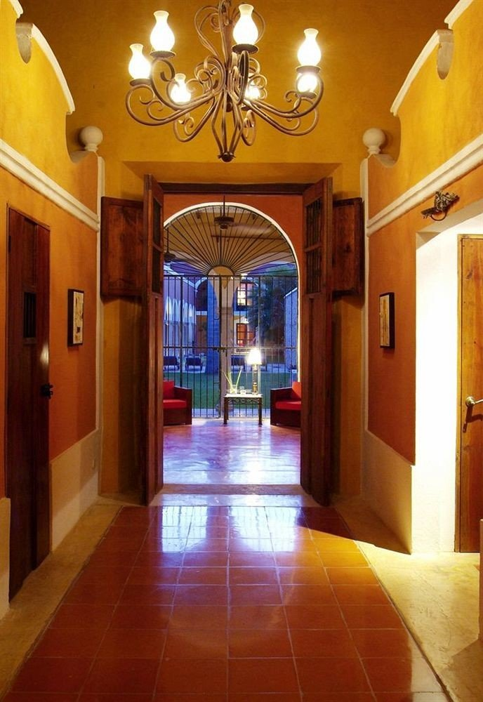 Lobby building property yellow mansion hall home hacienda tile tiled