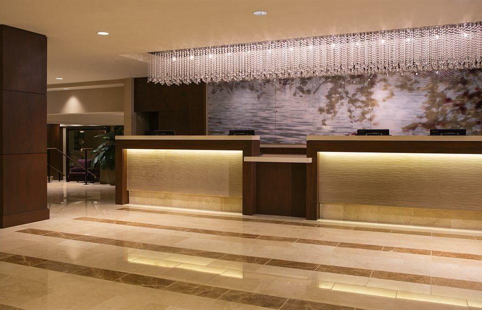 property Lobby flooring countertop hardwood cabinetry lighting wood flooring living room