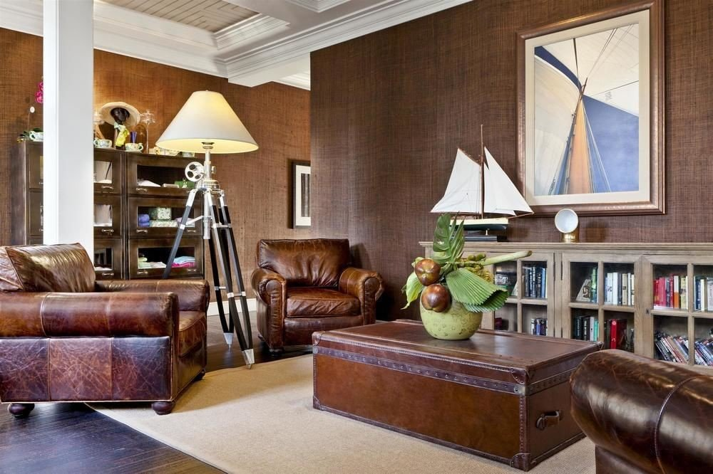 sofa living room property home leather hardwood wood flooring Lobby cabinetry