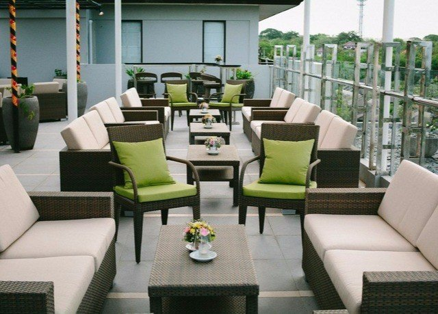 green sofa chair living room property condominium Lobby outdoor structure seat set leather