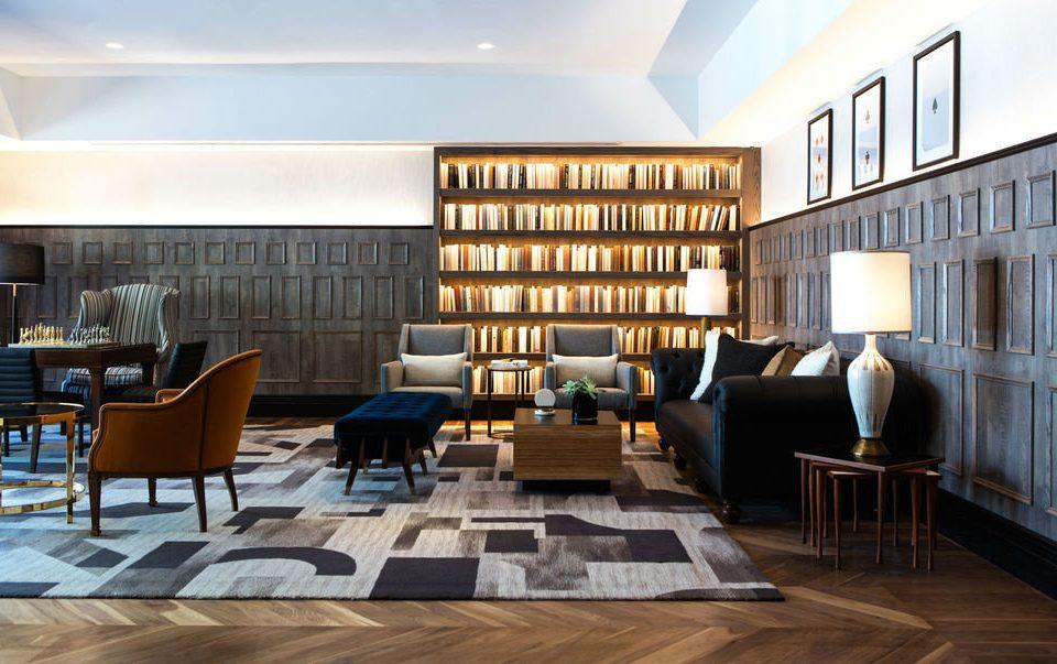 chair property living room home condominium hardwood Lobby loft wood flooring