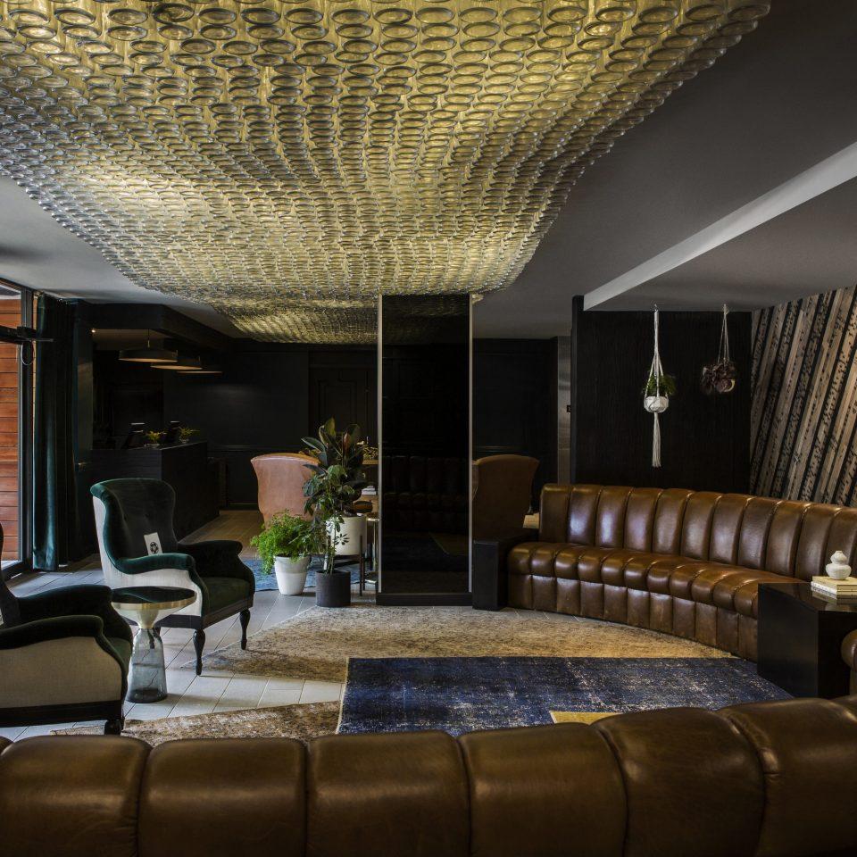 sofa chair Lobby property living room home condominium leather