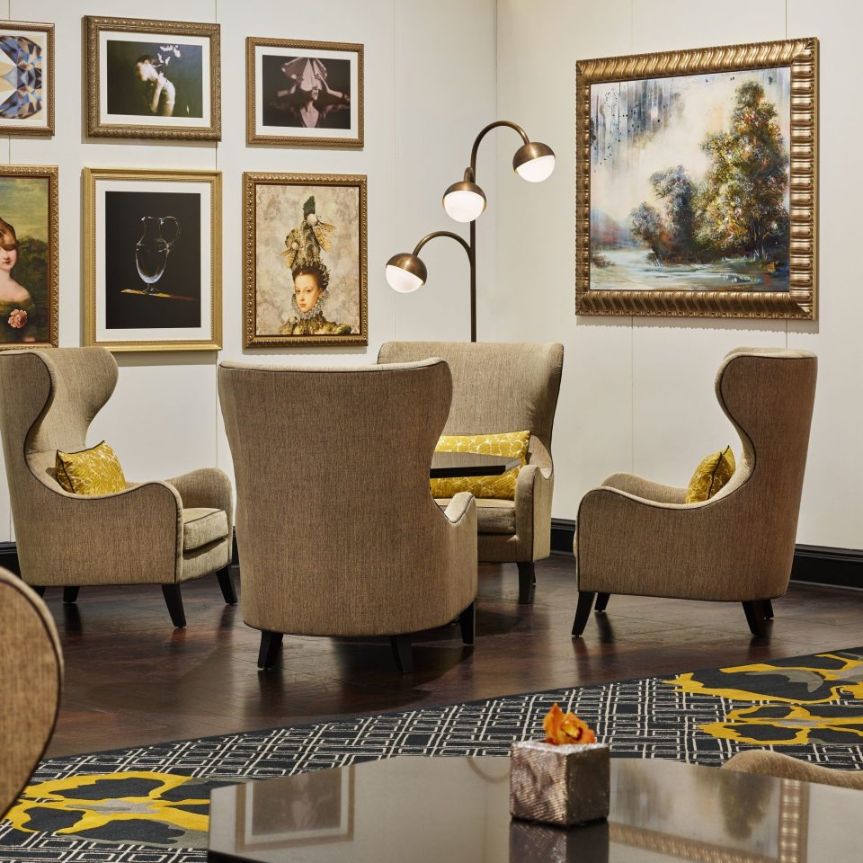 living room chair home flooring couch interior designer Lobby