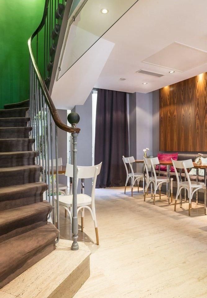 chair Lobby lighting stairs flooring restaurant