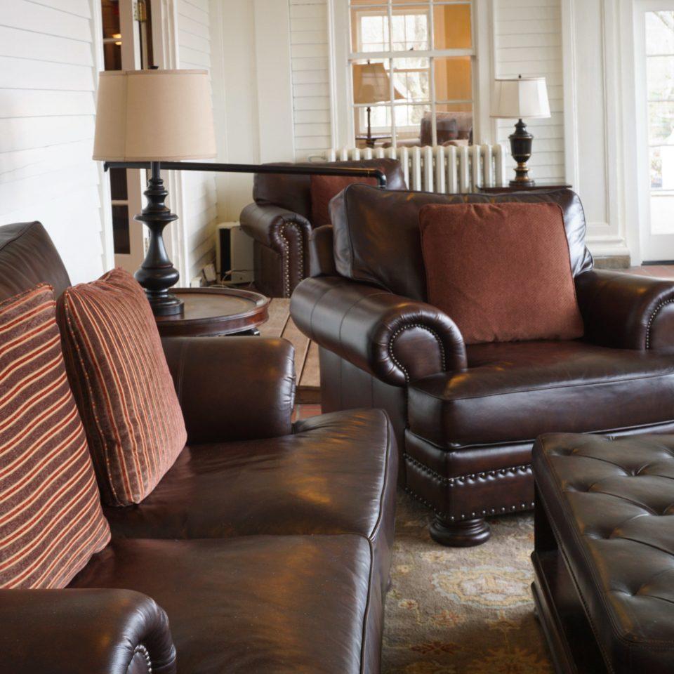 sofa living room chair property leather home hardwood Lobby loveseat