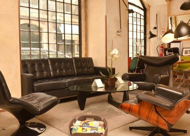 living room property home condominium Lobby couch leather cluttered
