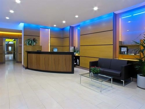 Lobby property condominium waiting room receptionist conference hall recreation room convention center