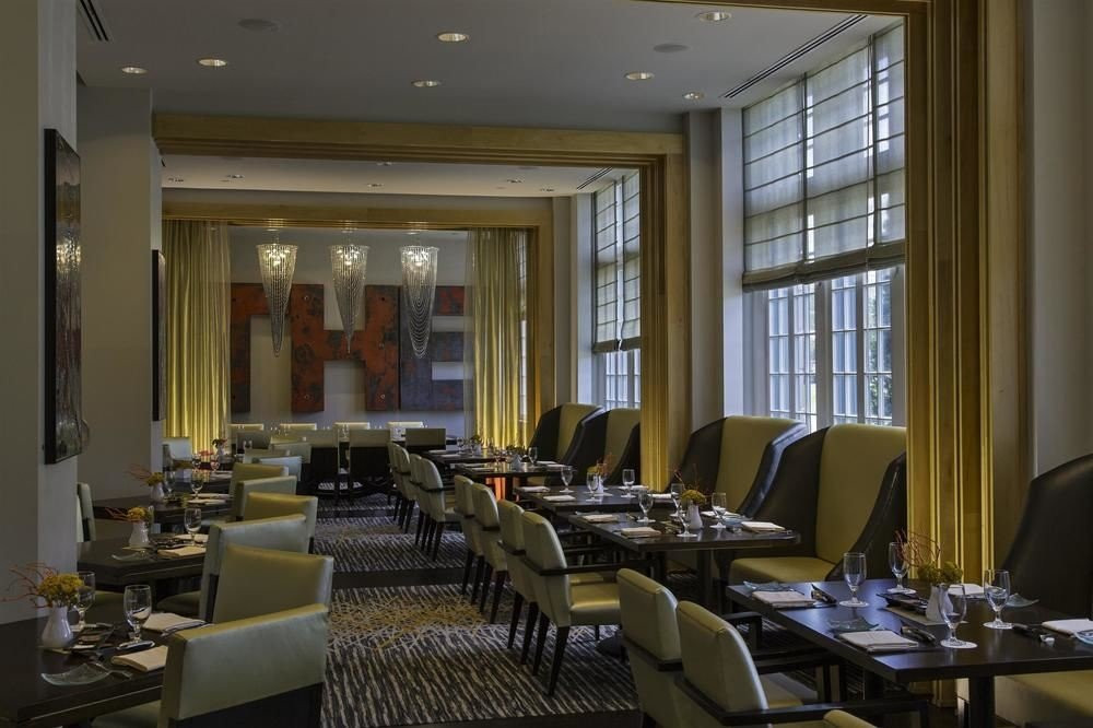 Lobby conference hall restaurant condominium living room function hall convention center dining table