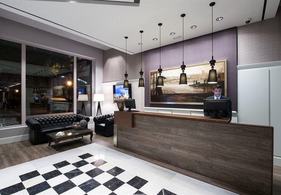 property Lobby living room home condominium flooring loft recreation room tile tiled