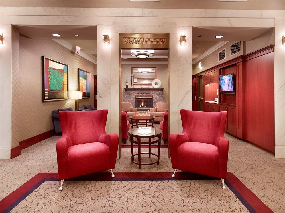Lounge Luxury red property living room chair Lobby home Suite recreation room waiting room basement leather