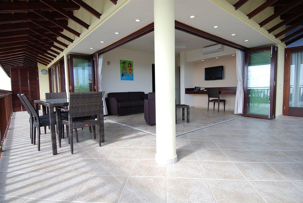 Lounge Luxury Tropical building property Lobby hardwood home flooring condominium Villa living room outdoor structure