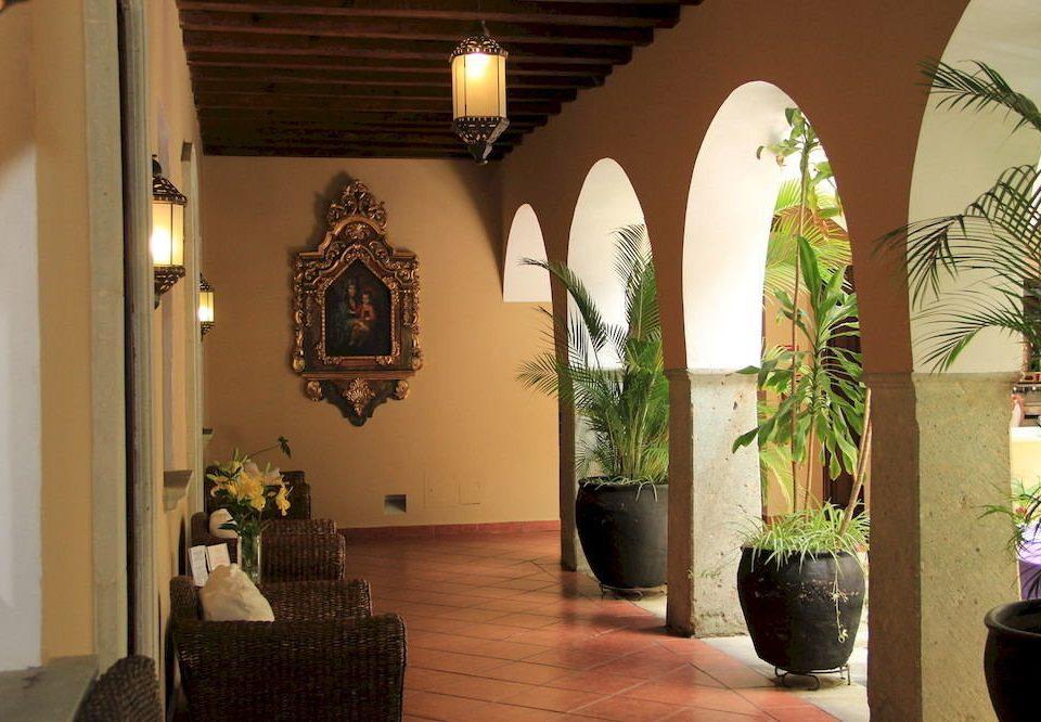 Lounge Patio Lobby house home plant hacienda tourist attraction hall living room