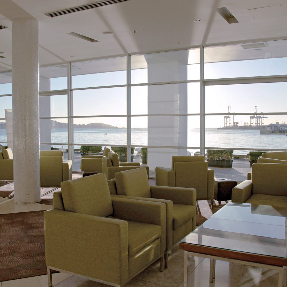 Lounge Patio Resort Scenic views Waterfront building office waiting room conference hall condominium headquarters classroom living room convention center Lobby