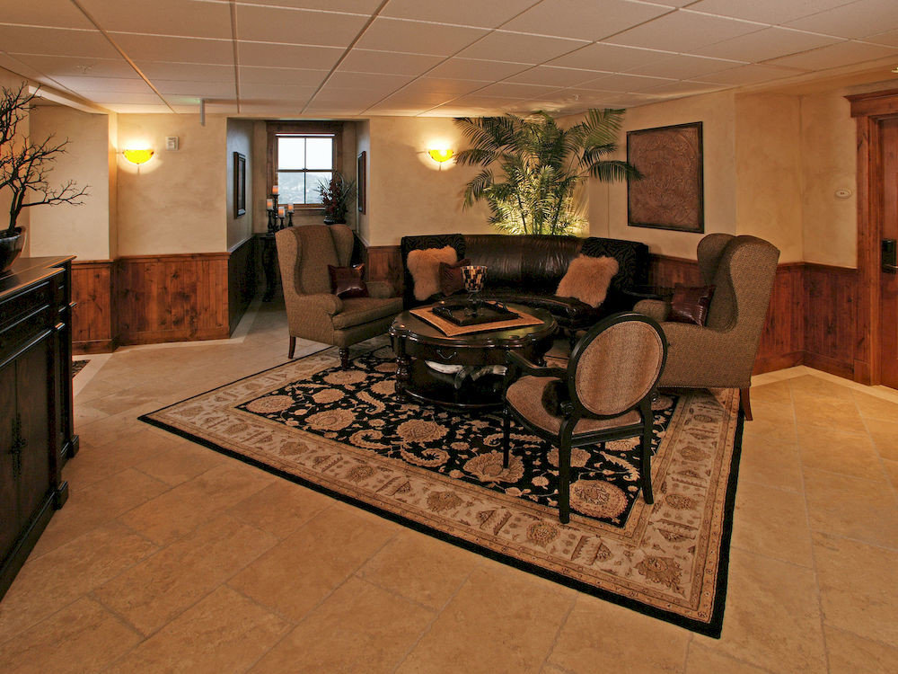 Lounge Resort property home living room Lobby flooring recreation room cottage Suite
