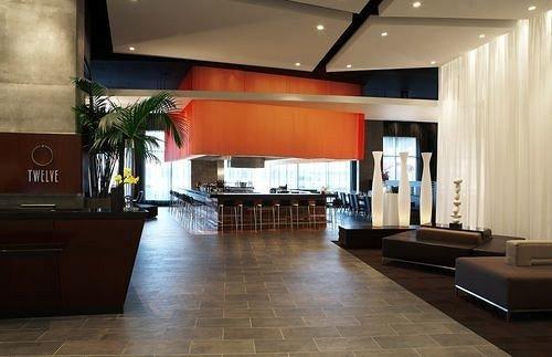 Lobby property living room auditorium flooring conference hall condominium receptionist Modern