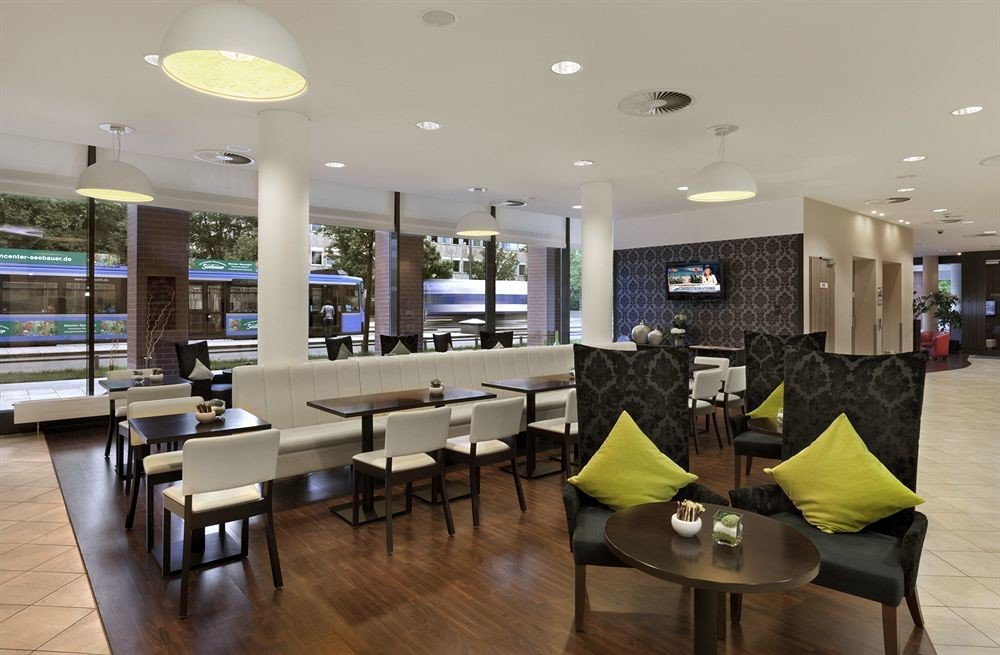 Lobby conference hall condominium waiting room cafeteria restaurant convention center Modern leather