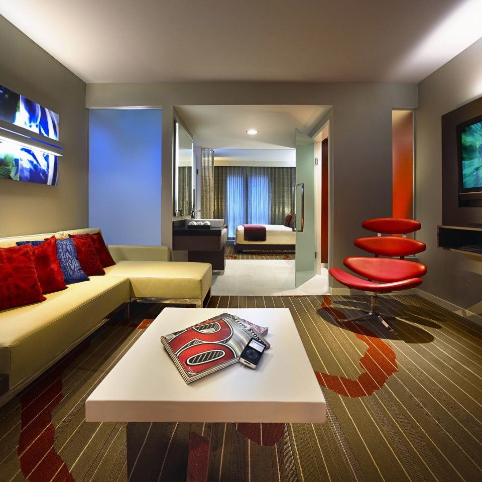 property television living room screen recreation room red flat Suite home condominium Lobby Resort Modern
