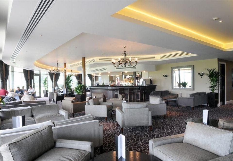 sofa property living room condominium home Lobby Villa Resort Suite Modern