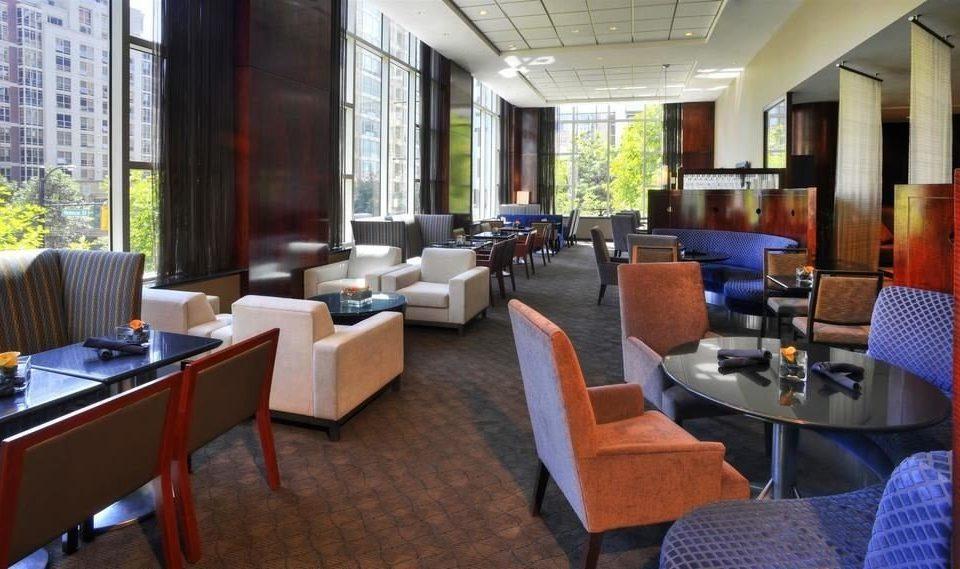 chair property restaurant Lobby condominium Suite Resort Modern