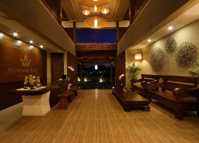 Lobby property recreation room billiard room lighting living room wood flooring function hall flooring mansion Suite Modern hard