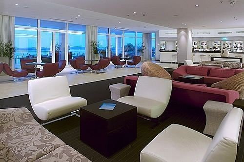 sofa chair property condominium waiting room Lobby living room conference hall Suite convention center Modern