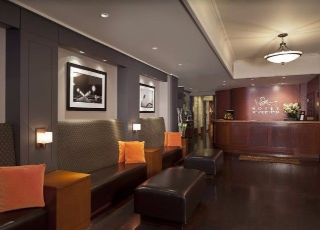Lobby property living room Suite condominium conference hall recreation room orange Modern