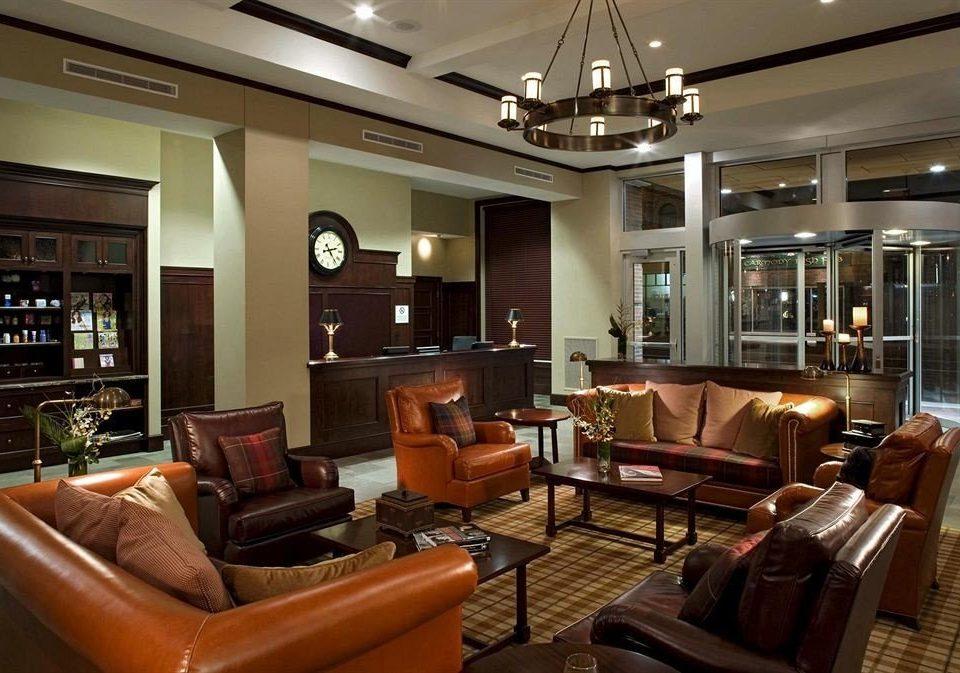 sofa living room property Lobby condominium leather home recreation room Suite flat Modern