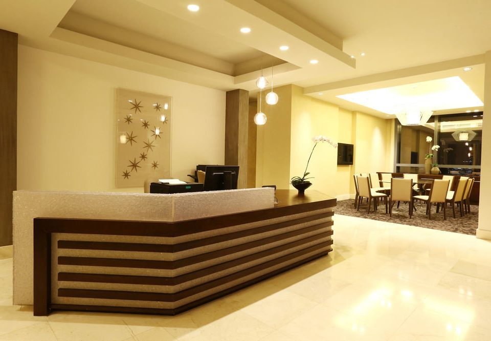 Lobby property home white living room receptionist Suite condominium Modern