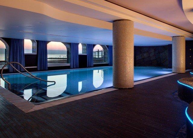 swimming pool property Lobby Resort recreation room blue