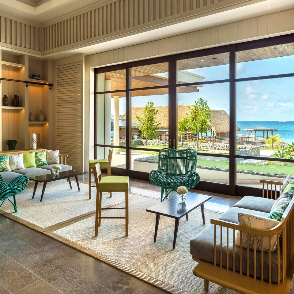 chair property living room condominium home penthouse apartment Resort porch Lobby house interior designer