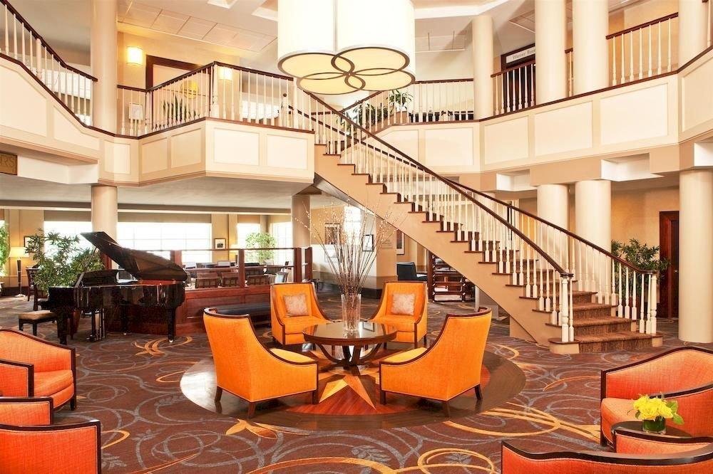Lobby chair orange property Resort home living room