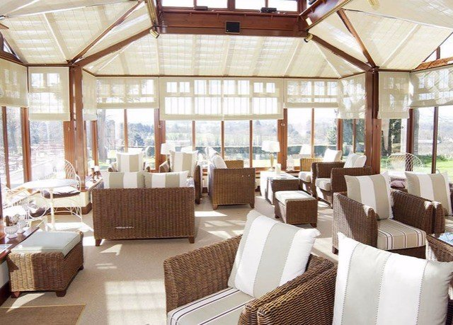 chair property Resort restaurant orangery outdoor structure living room Lobby
