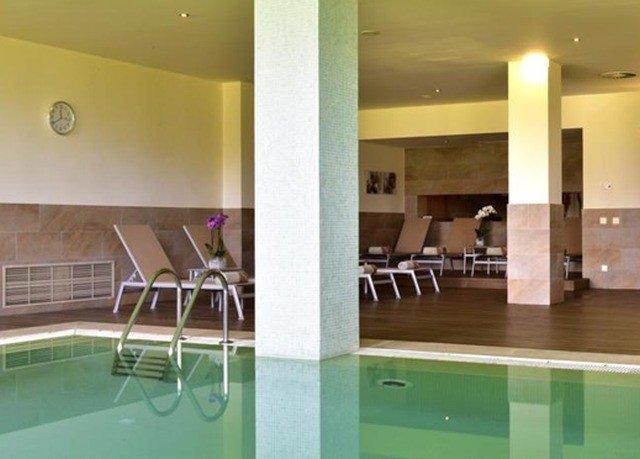 property condominium swimming pool lighting flooring green Lobby Resort