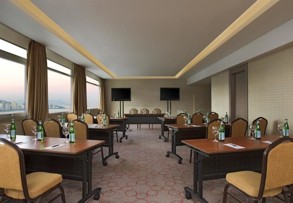 chair property Resort conference hall Suite condominium function hall restaurant Lobby convention center living room recreation room