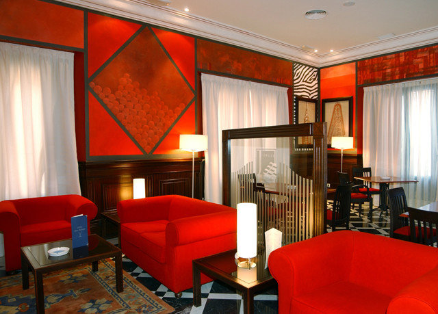red chair property Suite living room Lobby Resort leather