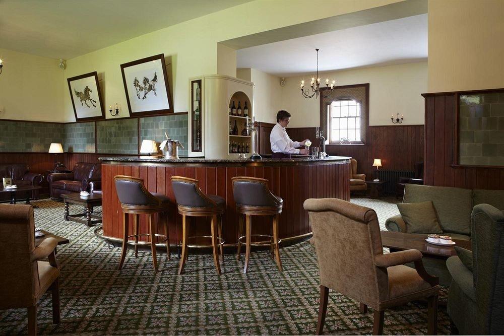 chair property Lobby restaurant Suite condominium living room Resort dining table
